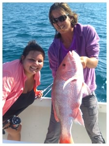 First Mate Melissa and guest angler with a Red Snapper