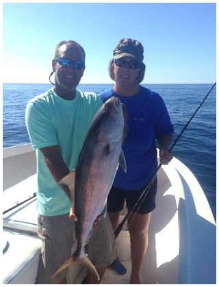 Captain Corey holds an Amberjack