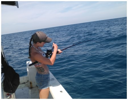Pulling up a catch while deep sea fishing