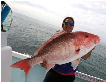 First Mate Melissa with a big red snapper caught near Daytona Beach